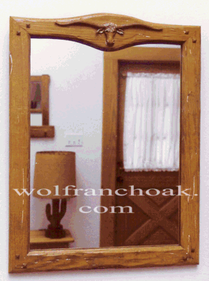 Longhorn-carved mirror